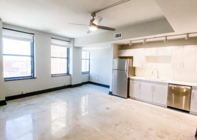 Open Living Spaces with Upscale Finishes at Merchants Plaza's Downtown Mobile Apartments
