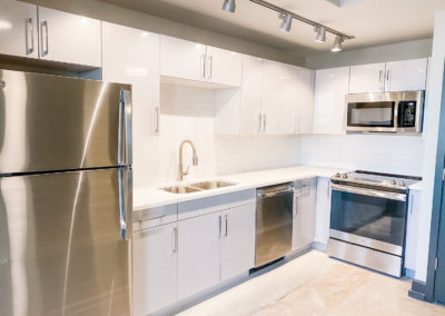 Refrigerator, Dishwasher, Glass-Top Stove, and More at Merchants Plaza's Downtown Mobile Apartments