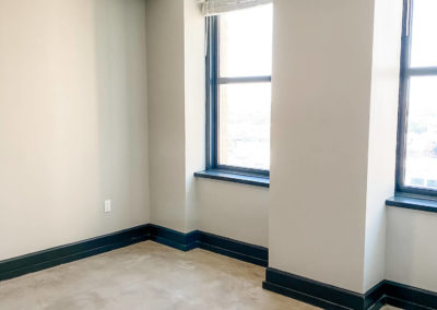Large Windows with Deep Window Sills in a Room at a Merchants Plaza Apartment
