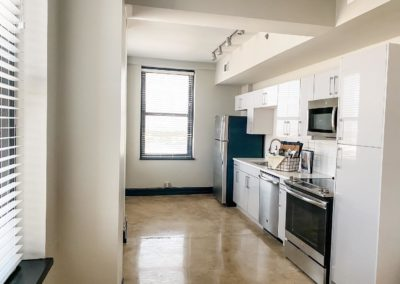 Refrigerator, Dishwasher, and Glass-Top Stove at Merchants Plaza Apartments