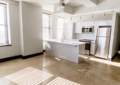 Empty Kitchen of an Apartment at Merchants Plaza