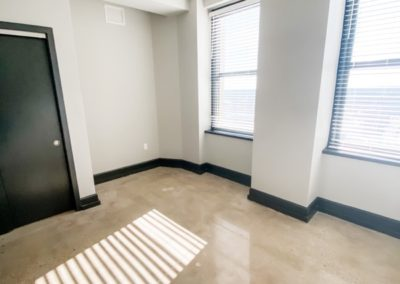 Large Private Bedroom at Merchants Plaza's Downtown Mobile Apartments