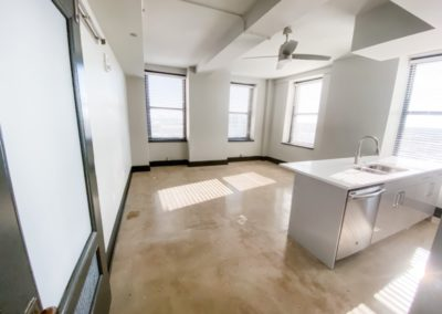 Kitchen Area with Ceiling Fans in an Apartment at Merchants Plaza