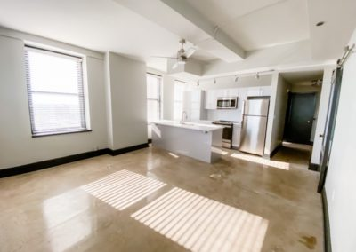 Open Living Spaces with Upscale Finishes at Merchant's Plaza's Downtown Mobile Apartments