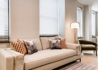 Couch with Pillows in a Living Room at Merchants Plaza Apartments