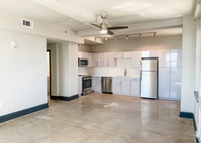 Spacious Kitchen Area with Natural Lighting of an Apartment at Merchants Plaza