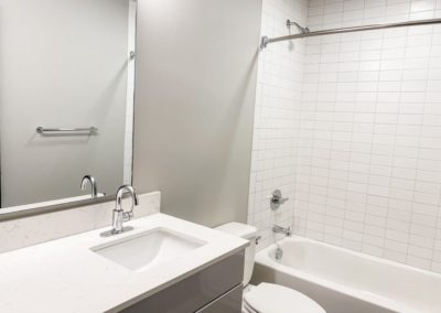 Bathroom with White Tiles of an Apartment at Merchants Plaza